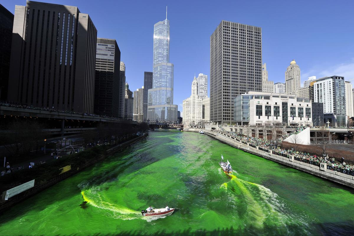 Members of the Chicago plumbers' union dye the Chicago River green for St. Patrick's Day in this March 17, 2012 file photo. The union started the tradition in 1962 with a material once used to locate leaks in buildings. Organizers say the powder used is a secret recipe and is environmentally safe.